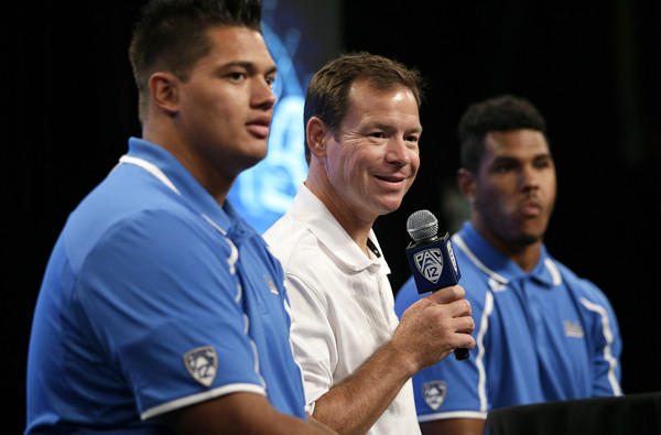 UCLA Coach Jim Mora is flanked by offensive lineman Xavier Su'a-Filo, left, and linebacker Anthony Barr during a media session this summer.