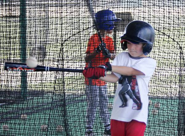 Murray Tucker practices his swing during baseball camp at Lake Sumter State College in Leesburg, Fla. on Monday, August 12, 2013.