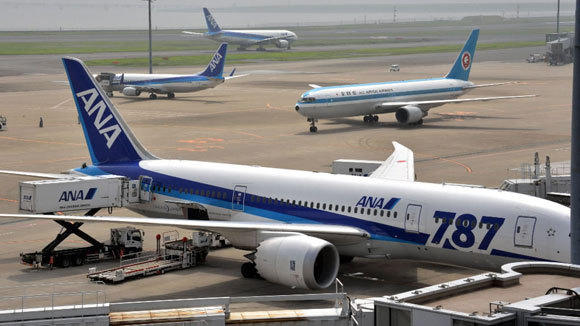 A Dreamliner is among the All Nippon Airways jets parked at Tokyo's Haneda Airport in July.