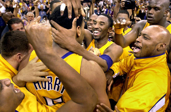 Robert Horry is mobbed by Lakers teammates after hitting the game-winning shot against the Sacramento Kings in Game 4 of the Western Conference finals in 2002.