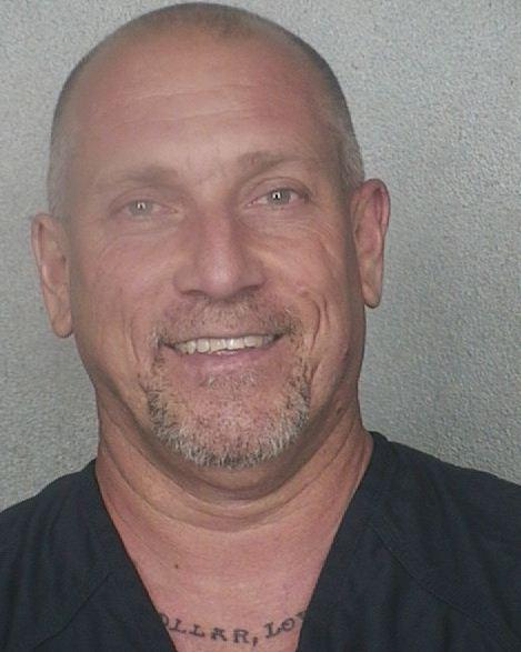 Former Hollywood Police officer Dewey Pressley, 46, surrendered at the Broward County Jail to begin serving a 90-day sentence for falsifying records after a police-involved crash.