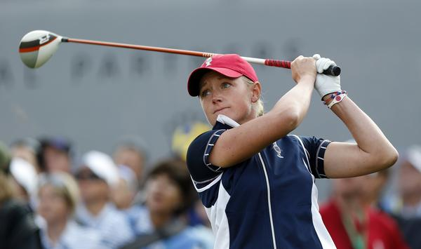 Stacy Lewis of the United States tees off on the first hole at the Solheim Cup golf tournament on Friday.