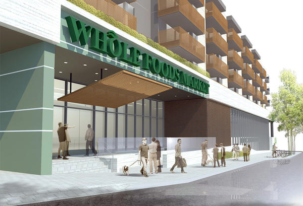 A rendering of the proposed Burbank Whole Foods Market and conjoining 241-unit luxury apartment complex that may be built at 3401 West Olive Ave.