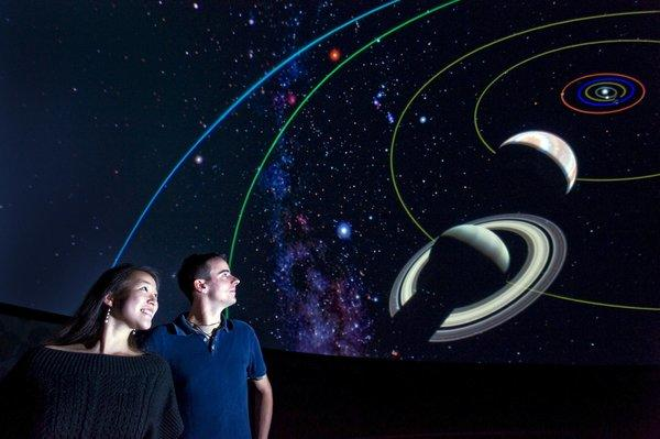 "Visitors take a journey through the solar system inside the Imiloa Astronomy Center in Hilo, Hawaii, the site of a ""fulldome"" festival that celebrates movies made to be shown in planetariums."