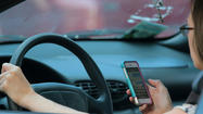 Hands-free cellphones for drivers may not be attention-getter