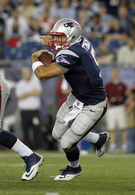 New England Patriots quarterback Tim Tebow (5) scrambles against the Tampa Bay Buccaneers during the third quarter at Gillette Stadium.
