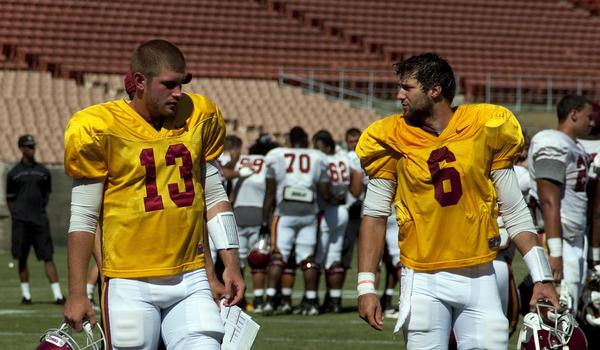 USC quarterbacks Max Wittek, left, and Cody Kessler walk off the field following Friday's practice at the Coliseum. Kessler performed well in the session.
