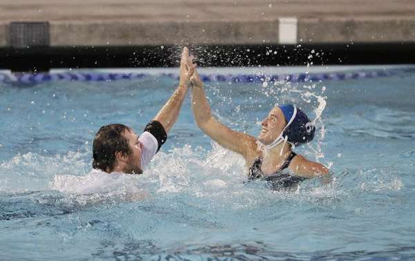 ARCHIVE PHOTO: First-year Crescenta Valley High girls' water polo Coach Brent Danna, left, high fives Caitlin Connell after the Falcons won the CIF Southern Section Division V championship. Danna has been voted the Glendale News-Press top coach of the 2012-13 seasons.