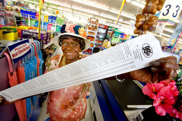 Emelia De-Four, 99, holds the receipt from her free shopping spree at the 99 Cents Only Store. She picked out 135 items valued at $143.88, including tax.
