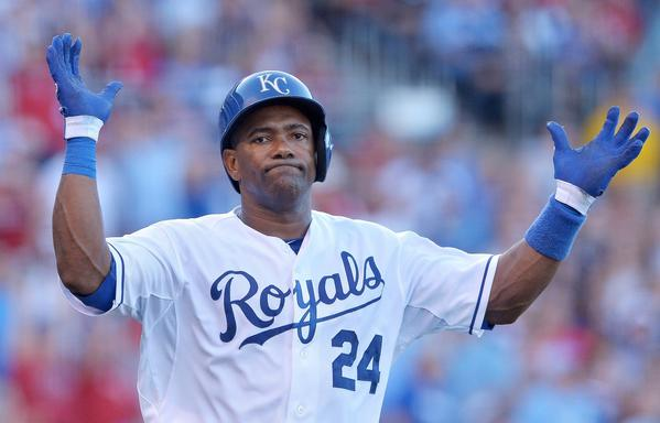 The Kansas City Royals' Miguel Tejada throws up his hands after flying out to end the first inning against the Boston Red Sox last week.