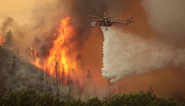 Helicopters battle the 92,000 acre Beaver Creek Fire on Friday north of Hailey, Idaho. Some 1,300 homes were evacuated, and the Sun Valley resort community was under pre-evacuation orders.