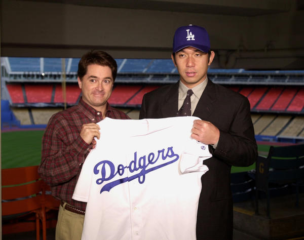 Dodgers General Manager Dan Evans with Hideo Nomo during press conference in 2001.