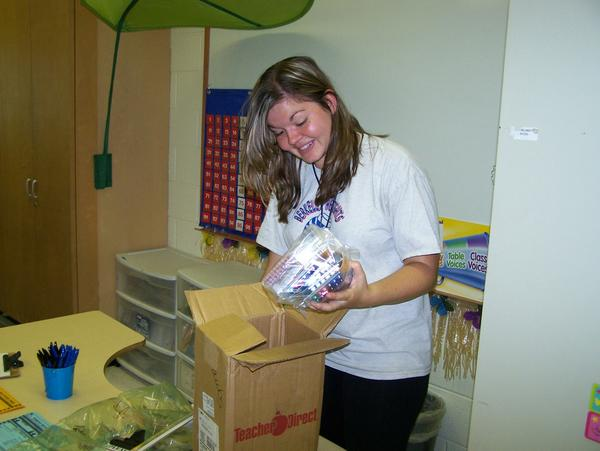 Berkeley Heights Elementary School First Grade Teacher Courtney Staubs unpacks a late-arriving box of supplies Friday afternoon in her classroom while preparing for the first day of school for students on Monday. Staubs is expecting to have 25 students in her class at the Martinsburg school.