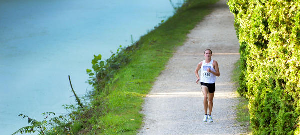 Michael Lilley runs alone on the C&O Canal Towpath on the way to victory in the Gary Brown Five Mile Run in Williamsport on Saturday.