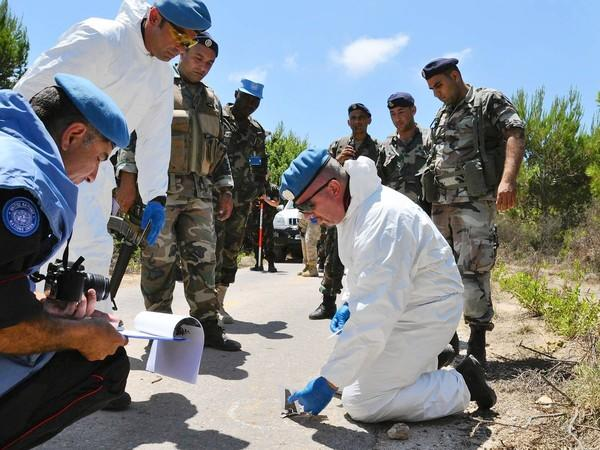 "United Nations investigators examine the scene of an explosion Aug. 7 in Lebanon that injured four Israeli soldiers. A U.N official called the reported Israeli incursion ""a serious breach"" of the resolution that ended the 2006 conflict between Israel and Hezbollah."