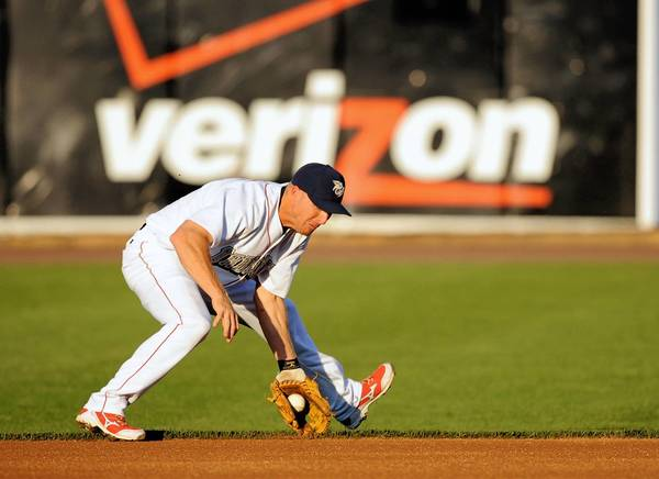 Second baseman Pete Orr makes a play against the Gwinnet Braves at Coca-Cola Park in Allentown on May 31, 2013.