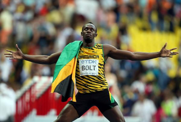 Jamaican sprinter Usain Bolt celebrates after winning the gold medal in the men's 200 meters during at the world track and field championship Saturday in Moscow.