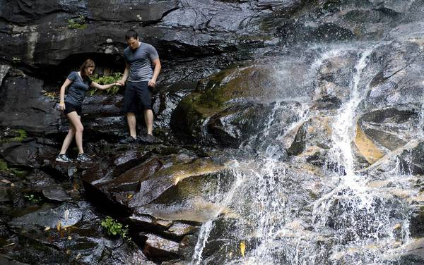 Josh Landis, of Pennsbury, and Nicole Moyer, of Barto, at the first waterfall at Glen Onoko in the Lehigh Gorge State Park in Carbon County on Thursday. Numerous deaths have occurred on the treacherous trail.