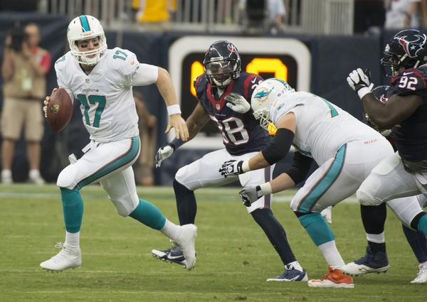 Ryan Tannehill (17) of the Miami Dolphins avoids a sack and scrambles against the Houston Texans in the first half of their preseason game on Saturday, August 17, 2013, in New Orleans, Louisiana. (George Bridges/MCT)