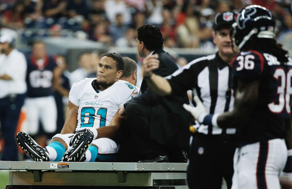 HOUSTON, TX - AUGUST 17: Dustin Keller#81 of the Miami Dolphins is carted off the f1eld after a rough tackle in the first half against the Houston Texans during a preseaon game at Reliant Stadium on August 17, 2013 in Houston, Texas. (Photo by Scott Halleran/Getty Images)