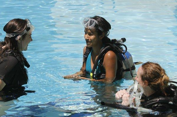 Maya Davies, 13 of Pasadena, left, and Nayelli Rojas, center, 13 of La Habra, come up after their first-ever scuba dive with instructor Lisa Jover, right, during a free, women-only introductory scuba lesson at Sport Chalet in La Canada Flintridge on Saturday, August 17, 2013.