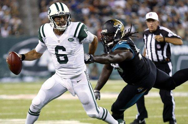 Jets quarterback Mark Sanchez (6) tries to evade the rush of Jaguars defensive tackle Sen'Derrick Marks in the first half Saturday night.