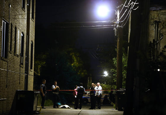 Chicago Police stand at the scene of a fatal shooting near Madison St. and W. Central Ave, on Aug. 18.