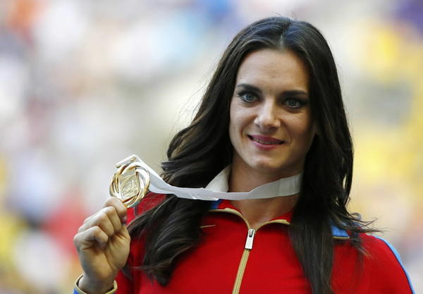 Gold medalist Yelena Isinbayeva of Russia holds her medal at the women's pole vault victory ceremony during the IAAF World Athletics Championships at the Luzhniki stadium in Moscow.