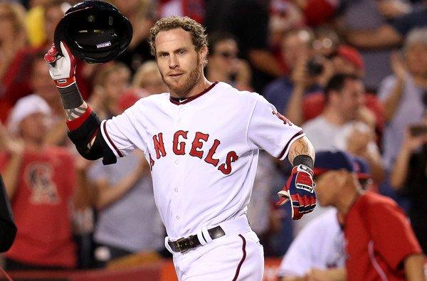 Angels designated hitter Josh Hamilton removes his helmet as he arrives at home plate to begin celebrating his walk-off home run against the Astros on Saturday night.