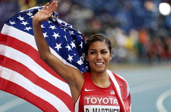 Brenda Martinez celebrates after earning a bronze medal in the women's 800-meter final at the world track championships Sunday in Moscow.
