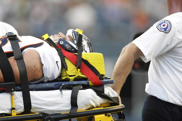 Denver Broncos defensive end Derek Wolfe (95) is wheeled off the field by medical personnel following an injury against the Seattle Seahawks during the first quarter at CenturyLink Field.