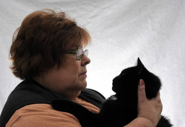 Animal communicator Terri Diener with Cosmus, a cat who really, really wanted to be let ouside.