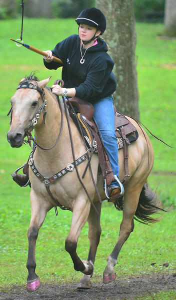 Danielle Gallupe of Knoxville, Md., practices jousting with her horse, Daisey, Sunday at Old Tilghmanton Tournament Woods in Fairplay. Rain cancelled the events for Fairplay Days at the park.
