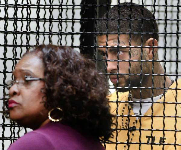 Human-trafficking suspect Curtis Maurice Canady, 19, right, and his lawyer, Public Defender Diane Herring, listen to the judge in Orange County Superior Court.