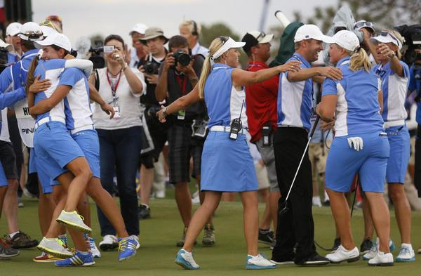 Caroline Hedwall of Team Europe celebrates with her team after holing her birdie putt on the 18th green in the singles matches to retain the 2013 Solheim Cup over Team USA at Colorado Golf Club in Parker, Colorado.
