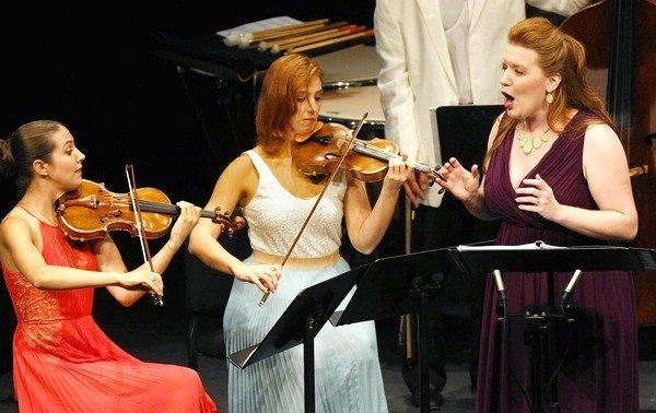 Meso-soprano Jennifer Johnson Cano performs the world premiere of John Harbison's, Crossroads with violinists Sarah McElravy, left, and Catherine Cosbey at the Summerfest 2013 in Sherwood Auditorium, La Jolla, on Aug. 16, 2013.