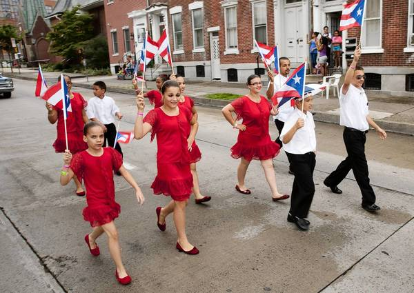 Tne 2013 Puerto Rican Parade heads down Fifth Street in Allentown on Sunday.