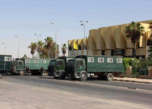 Egyptian security forces guard the North Sinai governorate building in Arish amid unrest in the area.
