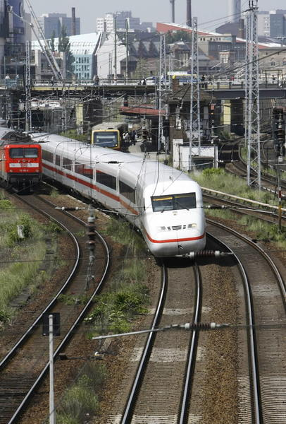 An ICE high speed train of German railway Deutsche Bahn AG (R) departs a station in Berlin.