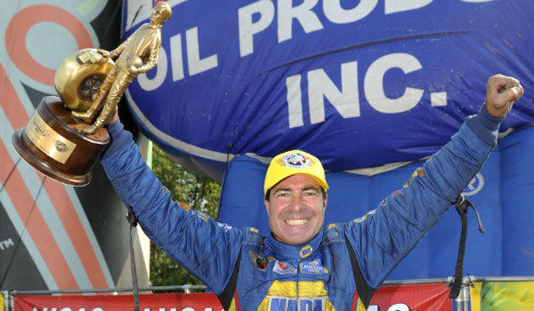 Funny car driver Ron Capps celebrates after winning at Brainerd International Raceway in Minnesota.