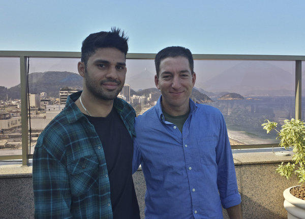 Guardian journalist Glenn Greenwald, right, and his partner David Miranda, are shown together in an undated photo at an unknown location. Miranda was detained for nine hours Sunday at Heathrow Airport.