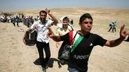 Syrian refugees flee amid clashes between Kurds and Islamist rebels