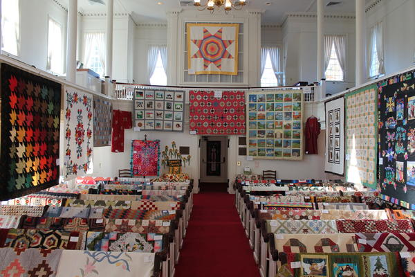 The Avon Congregational Church's second annual Harvest Quilt Show is in October. In this picture of last year's show, quilts are hung on the walls and on pews in the church.