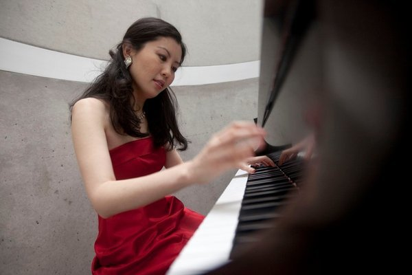 Psychologist Chia-Jung Tsay, pictured here at the piano, always wondered how much audiences (and competition judges) were influenced by what they saw, as opposed to what they heard. Quite a lot, her research shows.