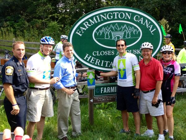 A group riding down the East Coast Greenway stopped in Farmington on Monday.