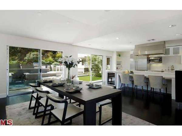 Sliding glass doors open to the yard of the home Dennis Quaid has put on the market at $3.15 million.