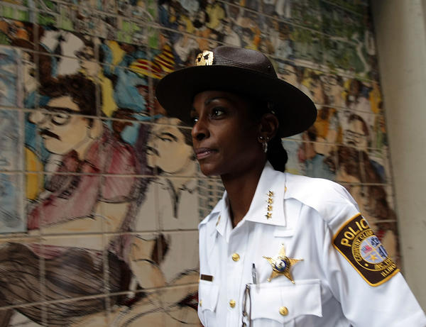 Then-Country Club Hills Police Chief Regina Evans walks to her car after leaving the Monadnock Building in Chicago in 2009.