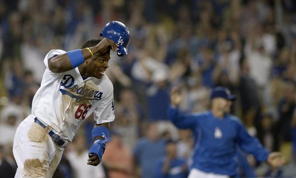 Dodgers outfielder Yasiel Puig celebrates after scoring the winning run in the bottom of the 12th inning against the New York Mets at Dodger Stadium earlier this month.
