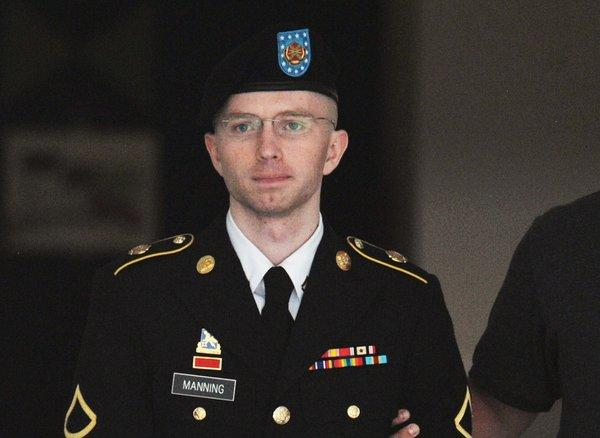 Army Pfc. Bradley Manning is escorted from court in Fort Meade, Md.