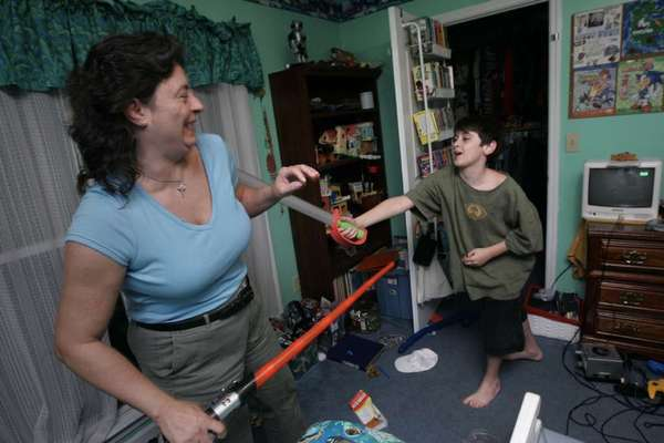 Julia Massey and son Ryan Massey, 11, right, play in his room at their Georgia home in 2007. Ryan is the youngest of three brothers in his family, all of whom have Asperger's syndrome, a milder variant of autistic spectrum disorder.